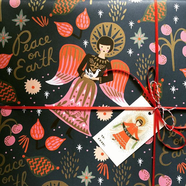 This gift wrap from @riflepaperco conveys the message of Christmas simply and beautifully#riflepaperco #christmas #angels #beautiful #thatsdarling #design #art #peaceonearth #greetingcards #presents
